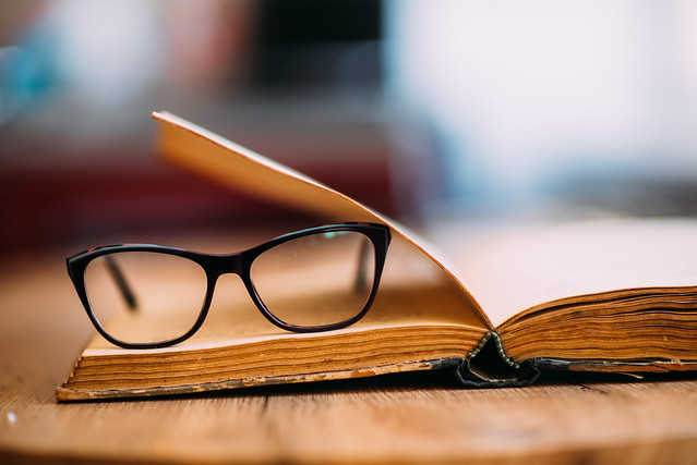 Glasses and old book closeup