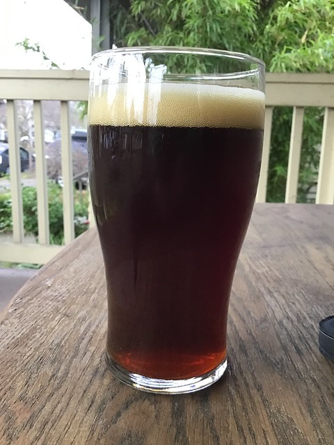 Ruben's brews Three Ryes Men barleywine in glass on table