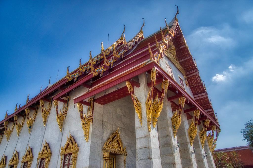 Wat Rakhang Khositaram by the Chao Phraya river in Bangkok, Thailand