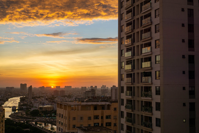 Sunset View of Ho Chi Minh City from a Balcony of an Apartment Building with Huge Cloud in the Sky in Saigon, Vietnam