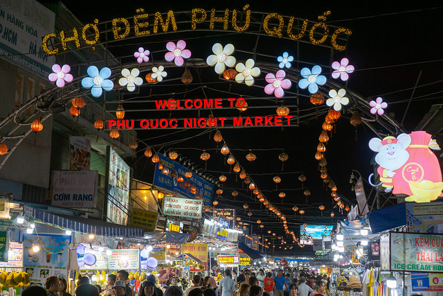 Many Street Food Carts, Shops, Restaurants and Massage Parlors at the Phu Quoc Night Market in Vietnam with Welcome Sign