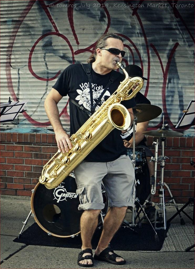 Saxist Jason Hayward. Music in Kensington Market.