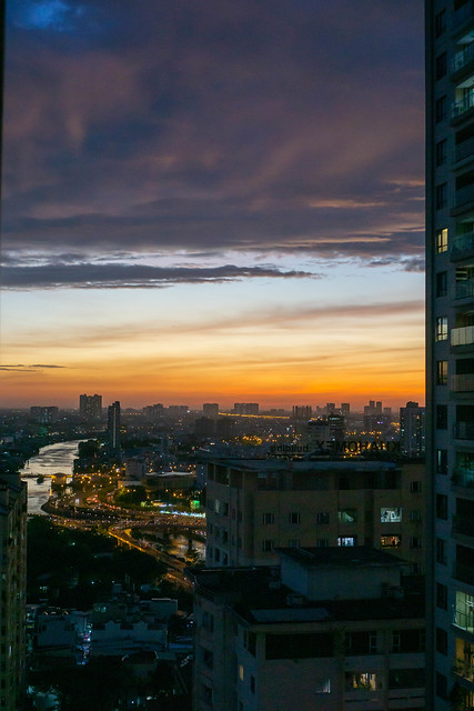 Last Minutes of Sunset at Golden Hour with View of Traffic in Ho Chi Minh City and District 5 in Saigon, Vietnam