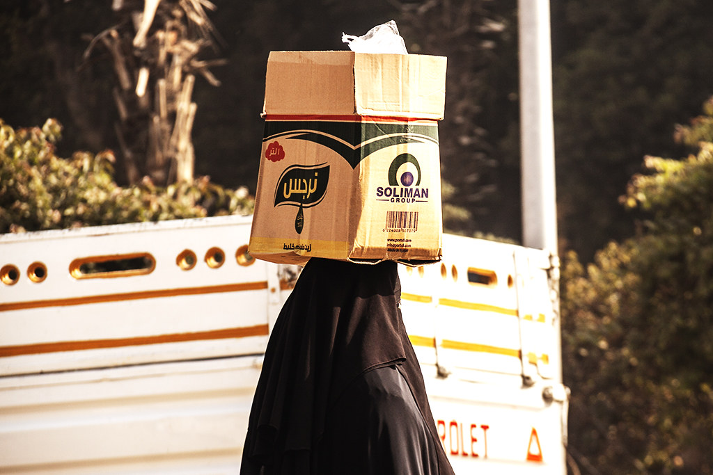 Woman with a box on her head in Old Cairo on 1-3-21--Cairo