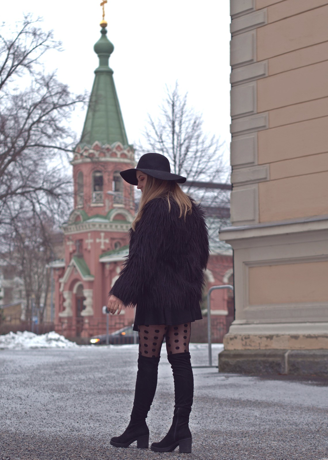 all black outfit with fur coat