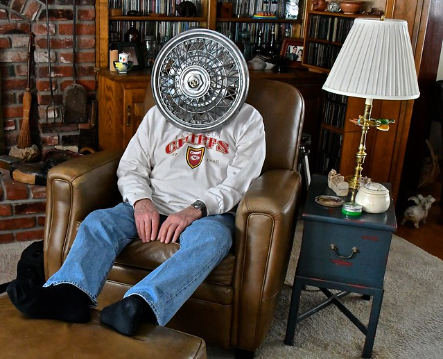 An Intimate Portrait of Hubcap Man Relaxing in His Easy Chair
