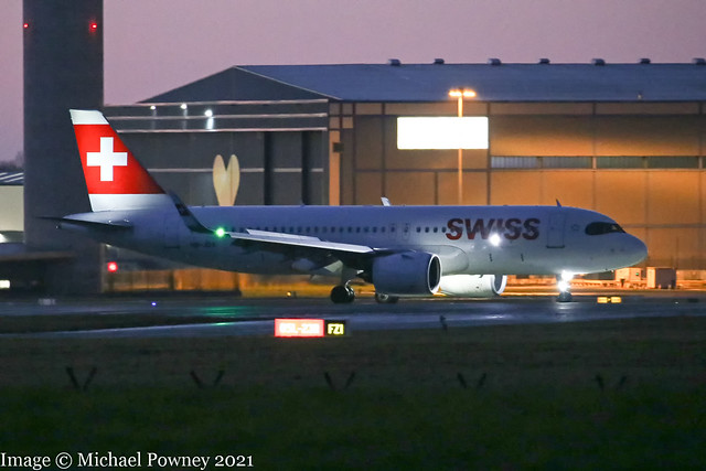 HB-JDA - 2020 build Airbus A320-271N, vacating runway 05L on arrival at Manchester at Sunset +45