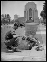Australian Soldiers outside the ANZAC Memorial, during a heat wave, Hyde Park, Sydney, 4 January 1946