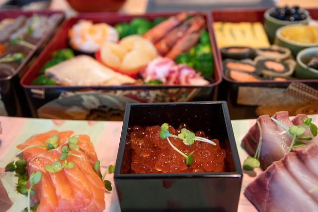 Akemashite omedetou gozaimasu. Osechi with sashime, zoni and Masae
