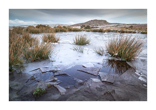 cheesewring stoweshill minions cornwall bodmin bodminmoor england britain uk ice icy pond puddle exposed wild landscape cold january winter snow