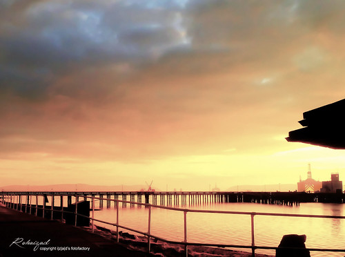 silhouette scotland cromarty rigs oil orange sky tint sea shadow morning sunrise inverness uk united kingdom town port nigg