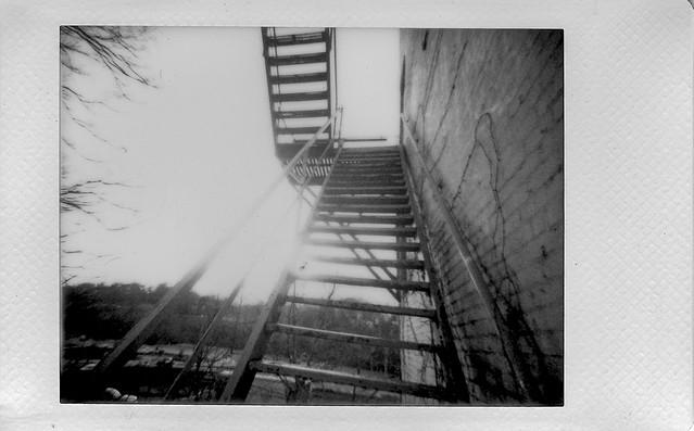 looking up, into the sun, fire escape, River Arts District, Asheville, NC, Lomo'Instant, Instax Mini Monochrome, 1.4.21