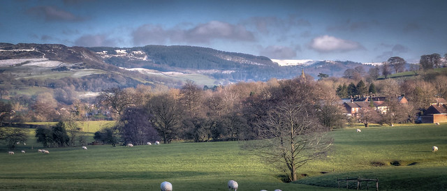 ..snow with sun on the higher hills, winter in January, Sutton, Macclesfield, Cheshire East, England....