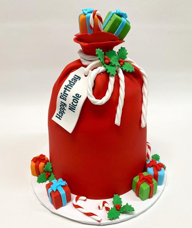Santa's Gift Bag cake by Dulce de Leche Cake Shop