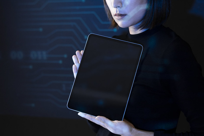 Asian woman showing blank screen tablet innovative future technology