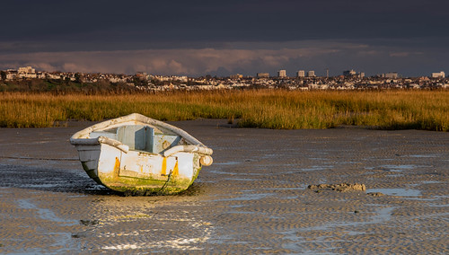 essex leighonsea twotreeisland dingy boat marsh landscape lowtide clouds mud