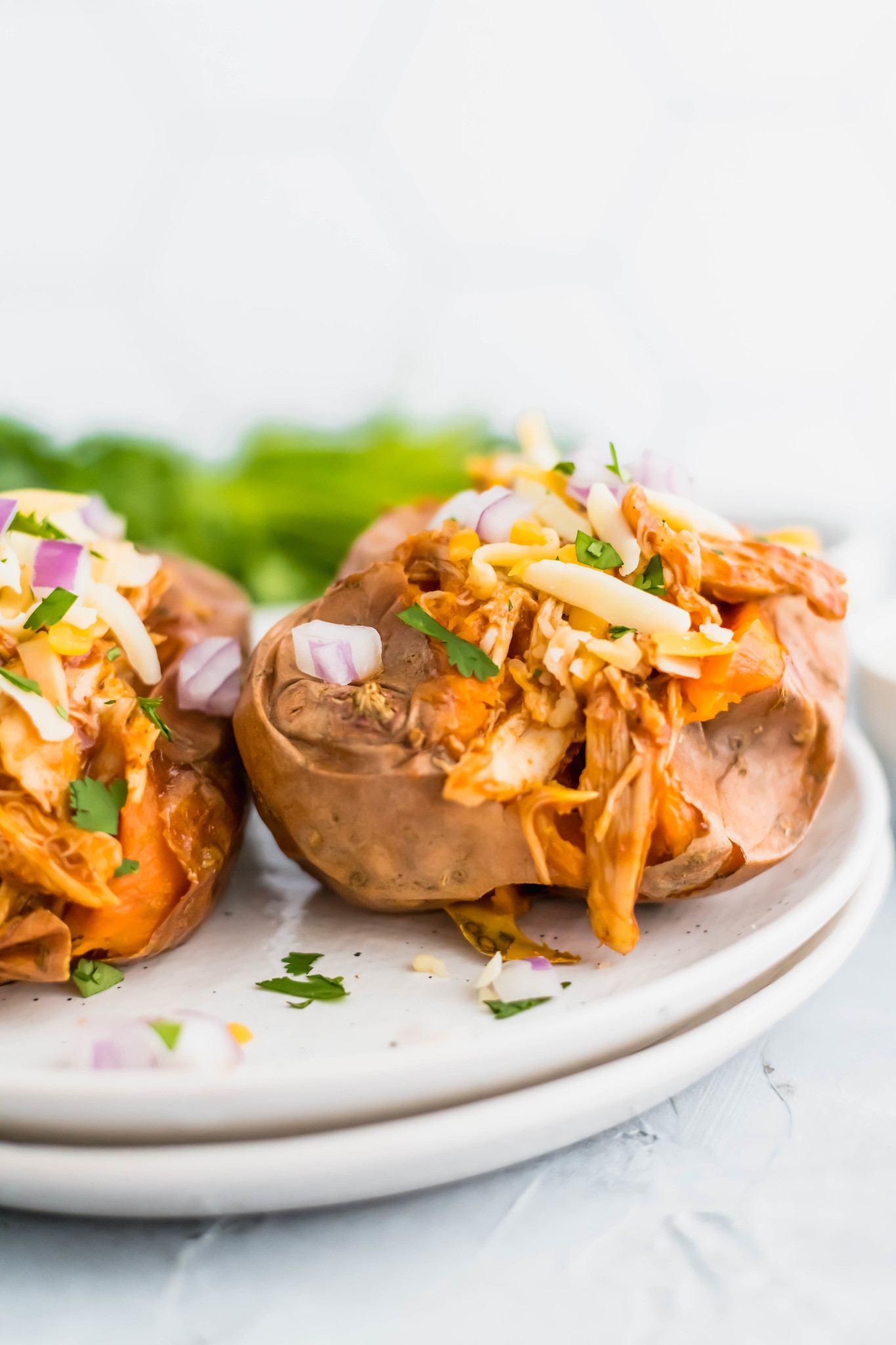 Eating healthy doesn't have to be boring. Especially with these BBQ Chicken Stuffed Sweet Potatoes around. Simple to prep and so yummy.