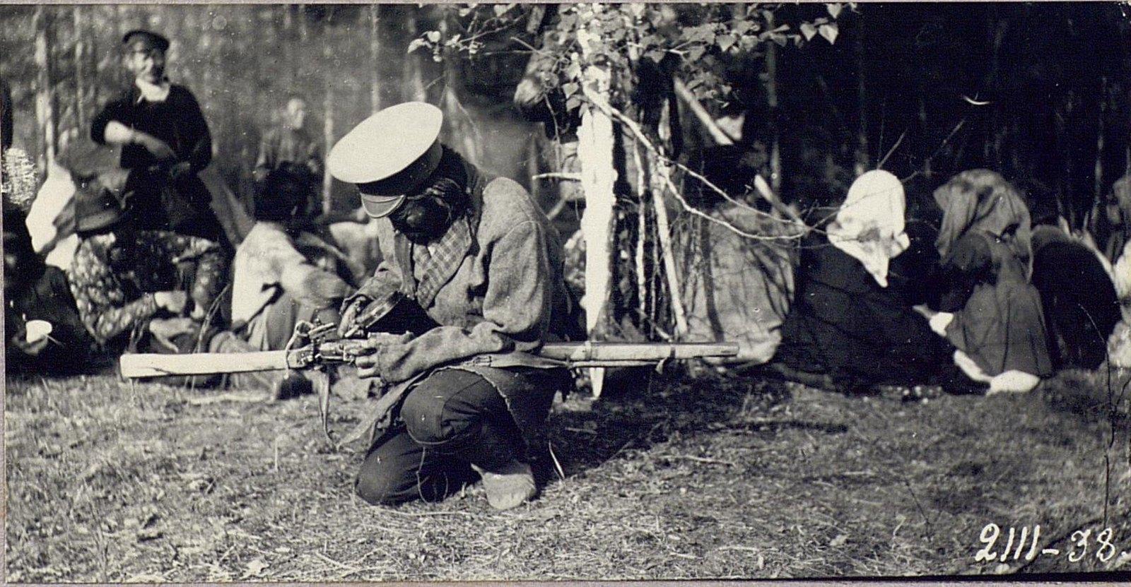 Орочен Илья с кремневой винтовкой
