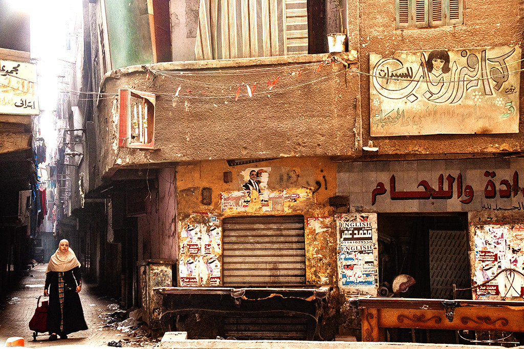 Woman emerging from alley on 1-7-21--Giza