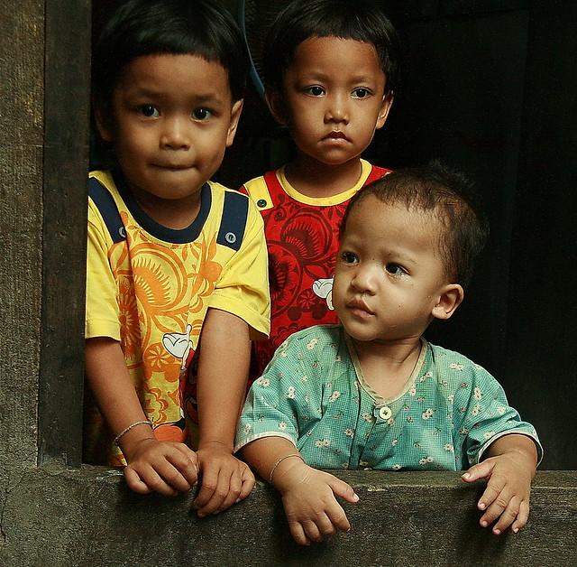 children in a doorway