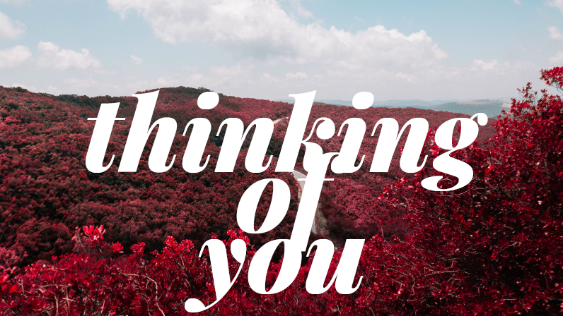 Thinking of you text over a scenic background