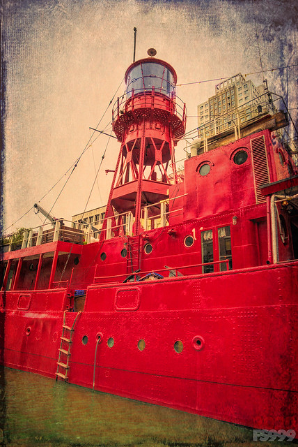 Red Lighthouse on Red Boat