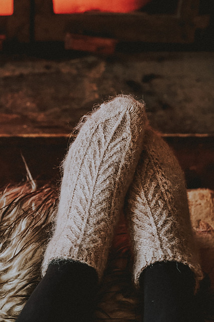 Lonely Forest Socks by Caitlin Hunter are cozy anklets knit from the toe up and featuring a texture inspired by pine boughs.