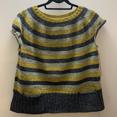 I finally finished the ribbing on my modified Stripes! by Andrea Mowry! I worked 5 inches of 2x2 ribbing and added pockets!