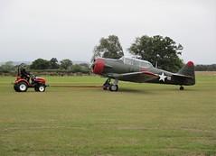 Harvard T-6G Texan G-BGHU is towed away at Headcorn Aerodrome, Kent 27.09.20