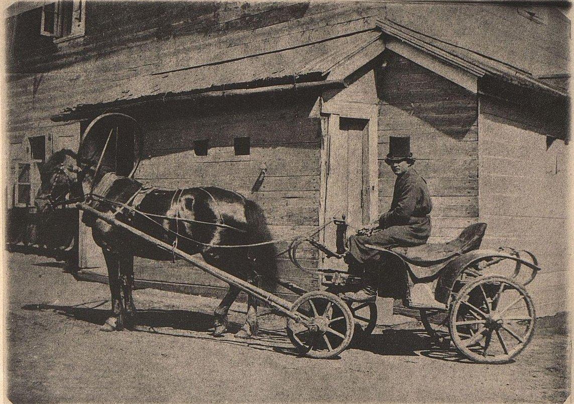 Извозчик на калиберных дрожках (»Ванька»). 1858