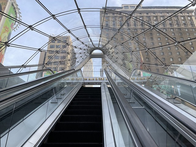 Pennsylvania Station NYC escalator with views of the Empire State Building Moynihan Train Hall Penn Station MTA LIRR Long Island Rail Road Amtrak train station Grand Opening January 1, 2021