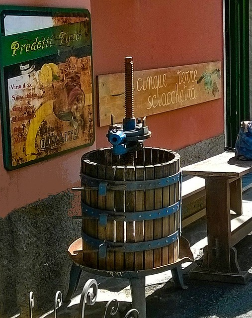 An ancient cast iron grape press in front of a winery in the Old Town of Monterosso al Mare