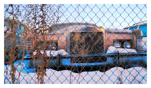 lincoln car beast boat fenced fujifilm x100v street snwo alberta canada edmonton alley backstorage winter old vintage lens rust headlights grass vanveenjf fujilovegear fujifanboys