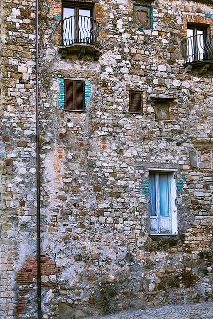 Windows, Balconies and a Door over a Wall