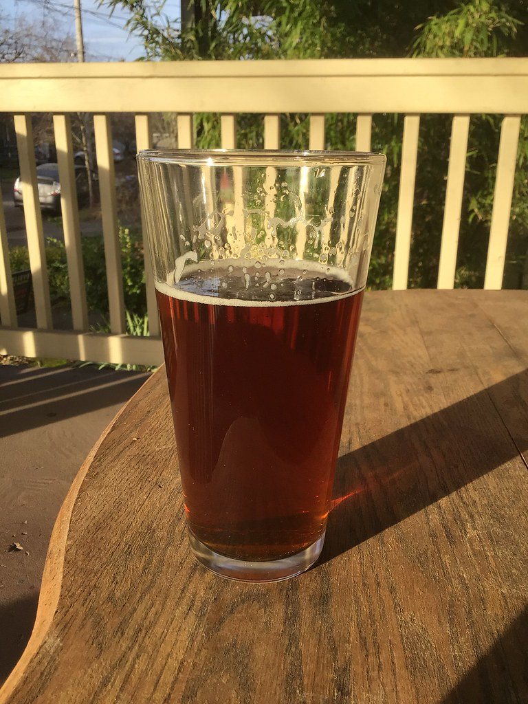 Stormbreaker ALTerior Motive ale in glass on table outside