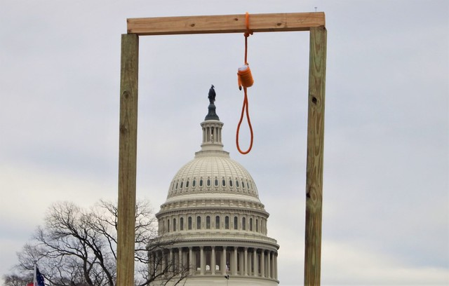 photo of gallows and Capitol from Jan 6 insurrection