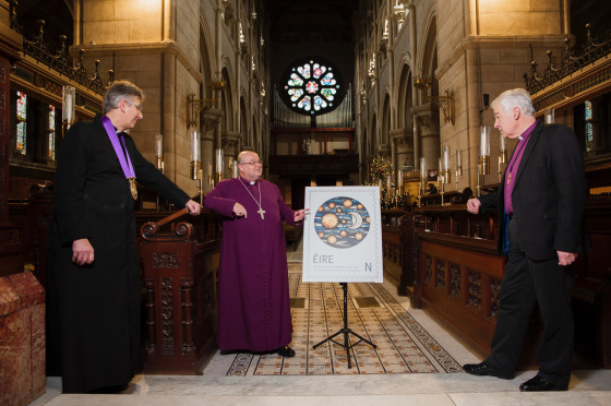 The Dean of Cork, the Very Reverend Nigel Dunne, and the Bishop of Cork, Dr Paul Colton, discuss the new stamp with the Archbishop of Dublin, Dr Michael Jackson, during his visit to Cork in December 2020. Photograph: Daragh McSweeney/Provision