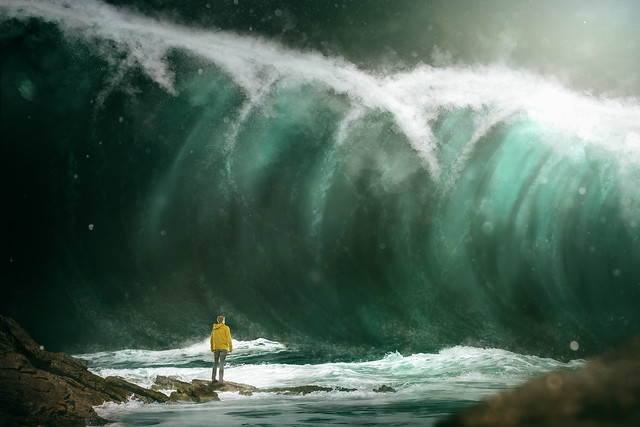 Man in front of a tsunami