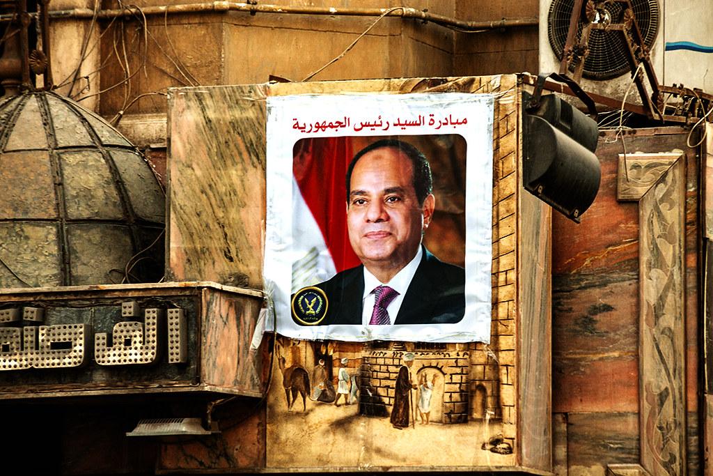 Al-Sisi on a Bab Al Louq building on 1-12-21--Cairo