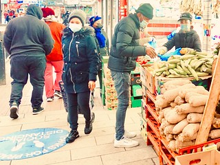Buying vegetables in Peckham