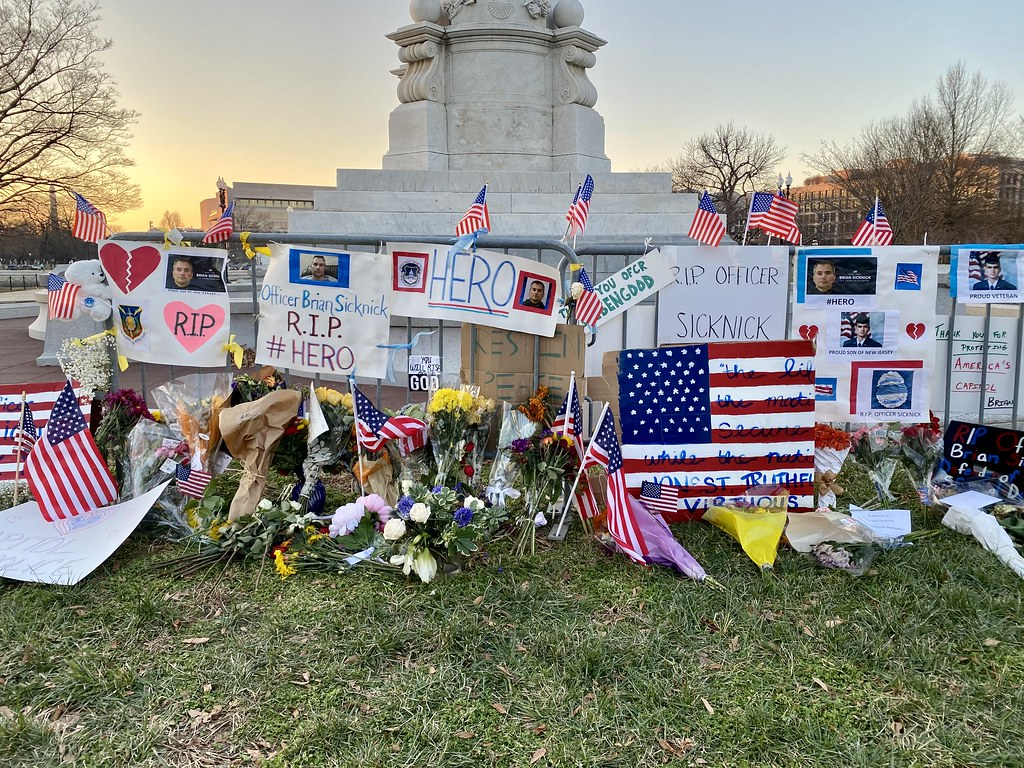 Tributes to Officer Brian Sicknick at the Peace Monument