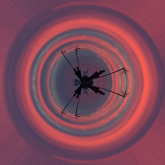 Sunset sky Drapers satelite tiny planet