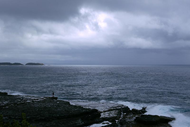 Lone person on Penguins Head rock shelf