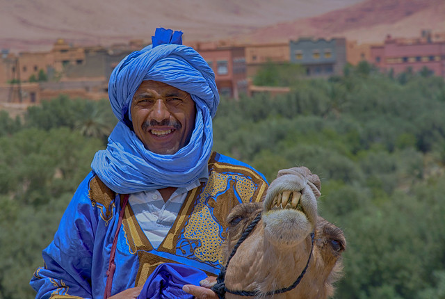 Blue man and camel