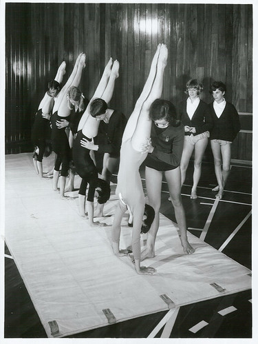 <p>Title:<br /> Physical education - Schools<br /> <br /> Publicity Caption:<br /> The 5th Form Girl's Gym Class, practising headstands in Gymnasium of Taita College, Wellington<br /> <br /> Photographer:<br /> R Silcock <br /> <br />  <br />  <br /> June 1968, Wellington <br /> <br /> Archives New Zealand Reference: AAQT 6539 W3537  82 /   A86461</p>