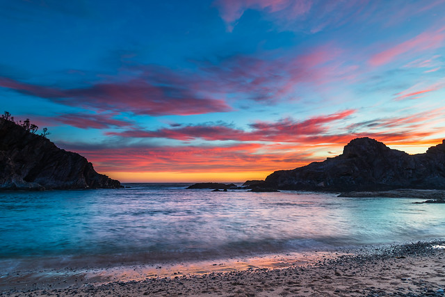 Colourful High Cloud Sunrise Seascape and Rock Formations
