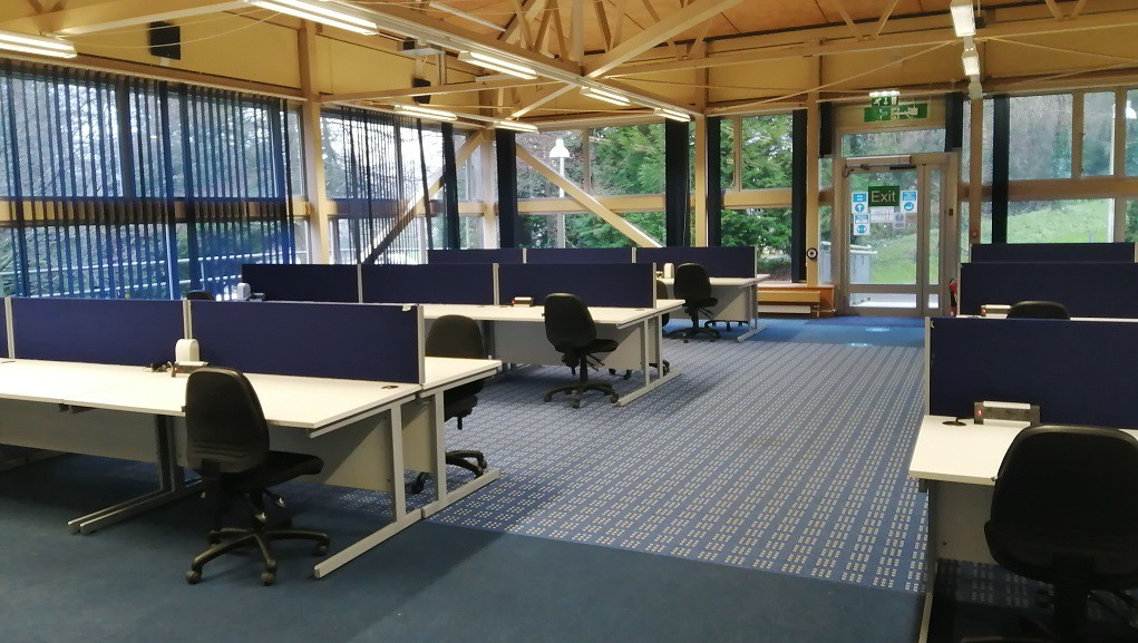 The 6WS Student Study Space with socially distanced seating and desk spaces, south facing view onto campus grounds