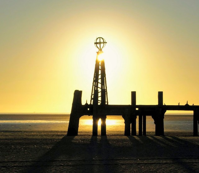 Low Sun over the old pier at St Annes