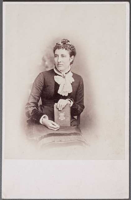 Cabinet card portrait of a woman with a book