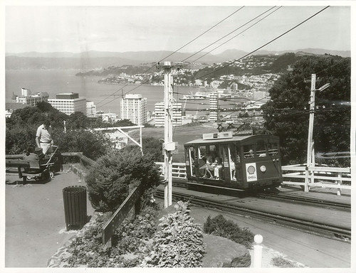 "<p>Title: Wellington City - Transport<br /> <br /> Publicity Caption: Visitors to Wellington enjoy the view from Lookout Point while riding in the cable car. Wellington Province.<br /> <br /> Photographer: R Anderson<br /> <br /> Archives New Zealand Reference: AAQT 6539 W3537 148 / B6485 <br /> <a href=""https://ndhadeliver.natlib.govt.nz/delivery/DeliveryManagerServlet?dps_pid=IE25368314"" rel=""noreferrer nofollow"">ndhadeliver.natlib.govt.nz/delivery/DeliveryManagerServle...</a><br /> <br /> To enquire about this record please email research.archives@dia.govt.nz <br /> <br /> Material from Archives New Zealand Te Rua Mahara o te Kāwanatanga</p>"
